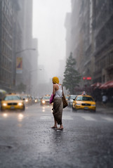 Iris blur (erinkinninmont) Tags: city nyc newyorkcity summer people woman usa ny newyork beautiful rain weather yellow lady dof taxi awesome taxis depthoffield unionsquare downpour taxicabs