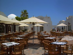book a table... (Mohamad Khedr) Tags: white umbrella chairs tables sharm elsheikh  dominacoralbay vision:outdoor=099 vision:sky=0671