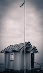 Lighthouse Keeper's Cottage (Per Salomonsson) Tags: sea blackandwhite lighthouse skåne sweden flag cottage smallhouse torekov lighthousekeeperscottage