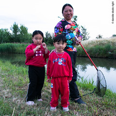 Chinese family (Davide Dodo Righi.) Tags: life china family autumn winter light boy red italy plant black tree eye home window girl look rain rose tongue fog night zeiss cat canon lost mirror vineyard scary fishing nik