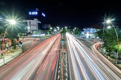 The man in red - Surabaya, Indonesia (Maria_Globetrotter) Tags: 2016 fujifilm indonesia mariaglobetrotter dscf16132 surabaya night traffic light trails le long exposure java infrastructure