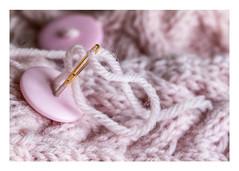 326/366: Finishing touches (judi may) Tags: 366the2016edition 3662016 day326366 21nov16 macro macromonday macromondays wristwarmers knitting yarn pink buttons needle stitch stitching wool canon7d pastel soft dof depthoffield