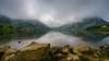 Foggy Twin Peaks (TanzPanorama) Tags: europe europa spain asturias covadonga lake lago lagosdecovadonga lakesofcovadonga glaciallake tanzpanorama sonya7ii ilce7m2 fe1635mmf4zaoss sel1635z variotessartfe1635mmf4zaoss hill reflection mist fog parquenational nationalpark ng lagodeenol travel mountainrange cantabrianmountains stone picosdeeuropa peaks twinpicks atmosphere