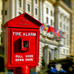ALARM (1crzqbn) Tags: lensbaby red sliderssunday intercontinentalmarkhopkins cubanflag alarm flags blur bokeh shadows sunlight lettherebelight emergency sanfrancisco theworldiswatching 1crzqbn