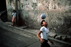 David Alan Harvey (hollysingerlow) Tags: ballobject boy3to13years decay exterior game hispanic openmouth pavement playing smile streetcorner tegucigalpa tshirt wallouter newyork usa