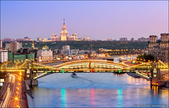 Evening Moscow skyline (Dmitry Mordolff) Tags: street bridge blue sunset sky house motion blur reflection nature water skyline architecture night skyscraper buildings river outdoors lights town spring downtown cityscape waterfront view place russia dusk moscow district cities landmarks illuminated russian residential embankment scenics locations landscaped