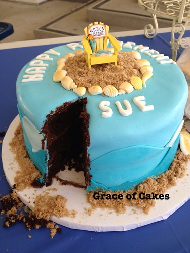 Beach themed retirement cake cut