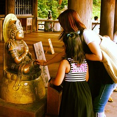 A mother prays with her daughter (sunsetbaytravel) Tags: trip travel people anime nature beautiful japan temple tokyo pagoda kyoto asia skyscrapers buddha pray praying nintendo manga hiroshima videogames temples trips nippon odaiba nara viaggi viaggio nagasaki giappone tempi tempio