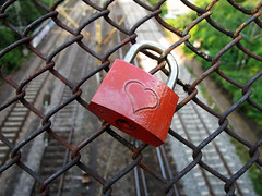 Promise of Love (Batikart) Tags: city trees light shadow red color green love metal closeup canon fence germany geotagged hope licht wire colorful europe friendship heart symbol stuttgart lock decoration tracks citylife tranquility railway romance stadt dreams rails zaun ur