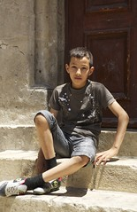 (Caitlin H. Faw) Tags: city light boy shadow portrait color june stone stairs canon eos israel sitting child legs jerusalem young sneakers 5d oldcity walled yerushalayim markiii austrianhospice 2013 caitlinfaw caitlinfawphotography
