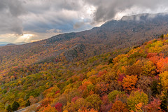 Rough Ridge dressed in its finest (snapdragginphoto) Tags: autumn sunset storm fall leaves clouds day cloudy northcarolina autumncolors boone sunbeam blueridgeparkway blueridge grandfathermountain roughridge linncoveviaduct pwfall