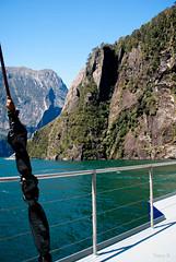 Straight down into the Sea (Jocey K) Tags: sea newzealand sky mountains water clouds boat ship scene cliffs nz southisland fjord milfordsound tasmansea lanscape mitrepeak fiordlandnationalpark southwestnewzealandworldheritagearea milfordmarner milfordsoundnaturecruise