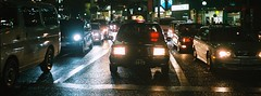 because I was there. (OFTO) Tags: street film car japan night 35mm fuji crossing taxi streetphotography olympus headlights osaka metropolis taxidriver umeda trip35 fujicolor xtra400 2013