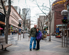 Mom & Dad (Michael Mendonca) Tags: christmas street city trip travel portrait people panorama blur wet mall dark lens 50mm grey lights store aperture nikon colorado downtown place bokeh thing background 14 free sigma denver pale software only photomerge nik middle process breckenridge 16th effect depressing tiltshift brenizer freelens