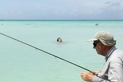 (Arthur van Beveren) Tags: blue sea pet man water hat los fishing venezuela zee bitch fisher bounty vissen humans roques mensen hengel