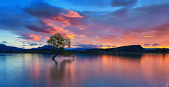 Sunrise at Lake Wanaka, New Zealand <3 (Taha Elraaid) Tags: newzealand sky lake nature water beautiful clouds sunrise wonderful landscape fire photography wanaka waterscape   tahaelraaid