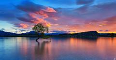 Sunrise at Lake Wanaka, New Zealand <3 (Taha Elraaid) Tags: newzealand sky lake nature water beautiful clouds sunrise wonderful landscape fire photography wanaka waterscape شروق الشمس tahaelraaid طهالرعيض
