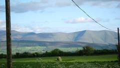 Sky line. (Gion Emlyeanu) Tags: blue sky white mountains clouds countryside wire scenery poles