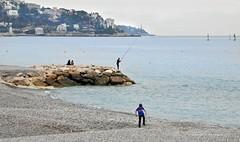 Fishing in Nice (Vee living life to the full) Tags: nice france tragedy promenadedupaillon terrorist attack riviera palmtrees sea memorial skater inline lone man rocks fishing gravel pebble beach nikond300