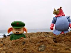 Mutual Mistrust Society (John 3000) Tags: toys juguetes montereycounty pointlobos california 2016 nature natureza cartooncharacters disney robinhood rhino pig oolong dragonball anime manga mistrust rock