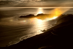 Marin County sunset (Pat Charles) Tags: sunset evening beach bay bayarea goldengatebridge sanfrancisco marin county reflection reflected reflections outdoor outside ocean water flare lens nikon california unitedstates america usa city waves coast sea clouds