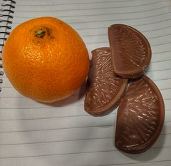 Choices choices. (tubblesnap) Tags: chocolate orange satsuma choices options terrys tangerine