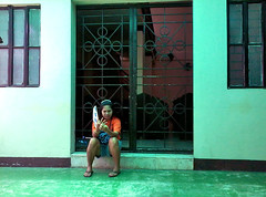 parent by the chapel (mikeeliza) Tags: orange woman brown shirt asian toes legs skin sandals philippines chapel parent manila denim shorts filipina mikeeliza