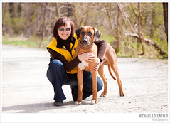 puppy love (mlofenfeld {MICHAEL LOFENFELD photography}) Tags: woman dog love bokeh human rhodesianridgeback connection gettyimageswants ownerholdingherdog