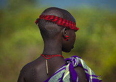 Bodi Tribe Woman, Hana Mursi, Omo Valley, Ethiopia (Eric Lafforgue) Tags: africa girls red woman beautiful beauty festival horizontal female outdoors photography nice day outdoor african ceremony culture newyear tribal celebration ornament beautifulwoman omovalley ritual rearview ethiopia tribe beautifulpeople oneperson headband developingcountry traditionalculture hornofafrica ethnology head