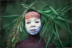 Suri Tribe, People of the Omo Valley, Ethiopia - Tribu Suri, Peuple de la Vallée de l'Omo, Éthiopie ( Jean-Yves JUGUET ) Tags: africa boy tree field kid child artistic culture tribal east tribes bodypainting tradition ethiopia tribe ethnic rite arbre surma adornment pigments ethnology tribu suri ethiopie ethnie suris kibish nomadicpeople tulgit peopleoftheomovalley turgit peuledelavalléedelomo