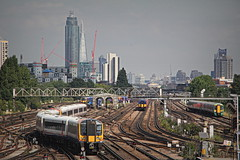 London Town from Clapham Junction (96tommy) Tags: new old city uk bridge england west london station electric skyline modern train buildings photography town photo footbridge britain south united capital great transport stock railway kingdom trains junction class southern transportation gb multiple emu electrical 450 clapham rare rolling unit swt 455 377 444 444035 450010 377475 455713