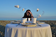 **Please,make them stop! (Despina Titoni) Tags: city family blue portrait sky color beach water girl female dinner table glasses fight sand photographer sad young levitation greece argument plates pigtails frustration conceptual katerini olympicbeach nikond3100