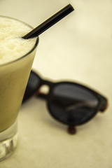 286/366: If you like pina coladas... (judi may - more off than on) Tags: 366the2016edition 3662016 day286366 12oct16 cocktail pinacolada sunglasses drink glass canon7d stilllife tabletopphotography