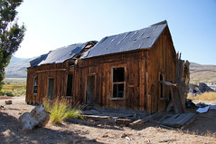 Parted Down The Middle (nedlugr) Tags: california ca monocounty highway395 hwy395 395 easternsierras house ranch ranchhouse shadows tinroof roof windows door weathered weatheredwood ruraldecay ruralwest rural rustic ruins omot