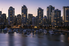 Marinaside (andre adams) Tags: reflections sunset water cityscape lights skyline yacht highrise ships blue hour condo citylights canada bc vancouver britishcolumbia marinaside longexposure urban architecture