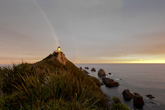 Rainbow at Sunset at Nugget Point (Derek Midgley) Tags: d754550 nugget point lighthouse evening sunset kakapoint new zealand