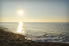 Morning light (beachaddictphotography) Tags: beach barton dorset morning sunrise winter sun flare sea shore coast stones rocks sand waves calm tranquil serenity