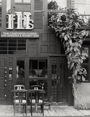 Confusion Cuisine (35mm) (jcbkk1956) Tags: bangkok thailand 35mm analog yashica yashinon ilfordpan100 rangefinder restaurant mono blackwhite film thonglo bar thai selfie reflection worldtrekker