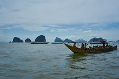 Phang Nga Bay (8mr) Tags: thai thailand phuket andaman sea water asia asian boat boating boats fishing imonaboat color longboat longtail motor floating float island islands limestone karsts phang nag bay phangnga krabi exotic south east ocean sky skies beach tourists tour tourist travel phase one flickrtravelaward
