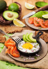 Fried egg, avocado and smoked salmon in frying pan (Katty-S) Tags: fried fry egg chicken avocado red green yellow fish salmon smoked salted pan breakfast morning lunch dinner hot served yolk bread rye food lifestyle wooden meal delicious snack english traditional health healthy fresh diet clean