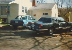 THE CAVALIER AND MY '86 MONTE CARLO IN 1991 (richie 59) Tags: ulstercountyny ulstercounty newyorkstate newyork unitedstates autumn generalmotors chevrolet townofesopusny townofesopus nystate richie59 stremyny stremy america outside fall chevycavalier cavalier montecarlo chevymontecarlo oldphotograph olddays oldpicture oldphoto film 1988chevycavalier 1988cavalier 1988chevy oct1991 1991 photoscan 1986chevy 1990s 1986chevymontecarlo 1986montecarlo 35mmfilm 35mm filmcamera filmphotography oct281991 1980scars americancars uscars 4door fourdoor 4doorsedan fourdoorsedan sedan bluecars 2door twodoor coupe chevys automobiles autos motorvehicles vehicles cars hudsonvalley midhudsonvalley midhudson ny nys usa us frontyard driveway backend taillights oldcars oldchevys