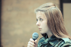 2014. Lviv. Ukraine. Bookforum (bobobahmat) Tags: ukraine ukrainian lviv lvov life people portrait performer face indoor city town street view military army soldier uniform woman girl performance microphone