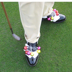 004 - Neil Paull's Seasonal Footware (Neville Wootton Photography) Tags: golf canonixus70 stmelliongolfclub neilpaull redhedzrollupxmastrophy