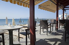 beach kardamena kos cafe view (Michael Blacktom) Tags: wood light sea summer sky sun seascape beach water lamp breakfast umbrella table awning restaurant cafe sand chair view post chairs kos greece tables taverna canopy seaview sunbed beachview beachumbrella kardamena sunrisekardamena