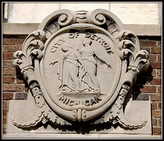 Former McGraw Street Police Station: Seal of the City of Detroit--Detroit MI (pinehurst19475) Tags: two architecturaldetail michigan stonework detroit stonecarving motto seal policestation basrelief architecturaldetails architecturalsculpture cityofdetroit twofigures sculpturalrelief cityseal classicalfigures speramusmelioraresurgetcineribus sealofthecityofdetroit wehopebetterthingsshallarisefromtheashes sixthprecinct mcgrawstreetpolicestation