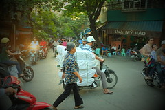 DSCF1272 (Konrad Lembcke) Tags: world life road street city trip travel people white house black art night trash children photography crazy cafe movement asia afternoon fuji view traffic transport documentary scooter center goods pinhole vietnam filter journey madness area rubbish moto motorcycle delivery commuter intersection merchandise local sight hanoi trade sreet bustle carry hao advanced discover hustle motocycle x100s