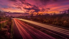 Amazing Sunset (Bjorn Gunnlaugsson) Tags: longexposure sunset red sun cars lines clouds lights motorway magenta shade hdr canonef1635mmf28liiusm canoneos7d