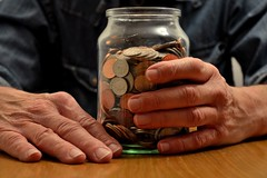 Holding Savings Jar (A-Lister Photography) Tags: uk england money horizontal closeup silver table landscape person holding hands hand adult coins body save cash pot copper jar saving savings held economic financial economy issues currency glassjar hold counting pension count reallife finance currentaffairs selectivefocus saver pensioner partof finances realpeople pensions differentialfocus adamlister finanaces nikond5100 alisterphotography cashingup