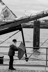 Hart am Wind (FriendFisherman) Tags: city bw white black girl rain port umbrella river nikon wind harbour hamburg scene hafen regen elbe schirm d7000