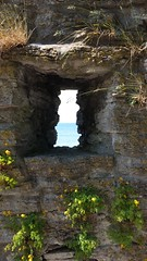A peek hole thru the Visby stone wall on Gotland Island in Sweden over Baltic Sea - Samsung Mobile Picture (Photomiqs) Tags: sea sunshine sweden gotland samsungs4 stoonewall